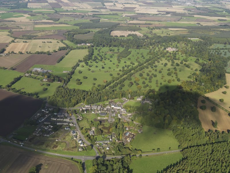 General aerial view of Glamis Castle and its Policies with Glamis Village in the immediate foreground taken from the SE.