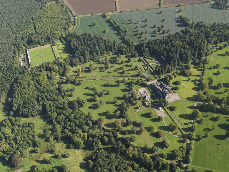 General oblique aerial view of Glamis Castle policies centred on Glamis Castle, taken from the W.