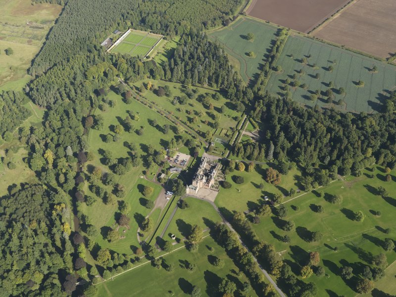 General oblique aerial view of Glamis Castle policies centred on Glamis Castle, taken from the SW.