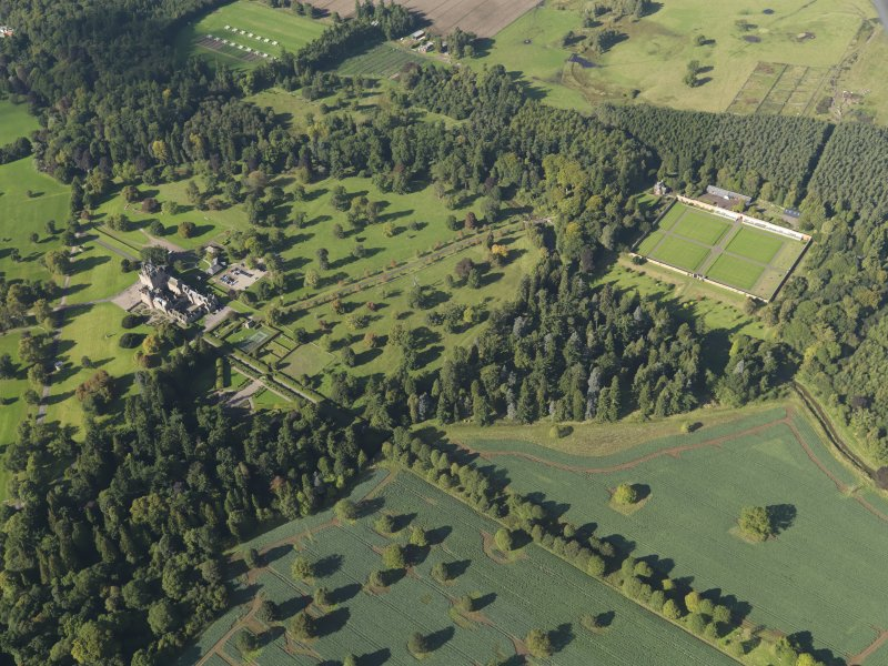General oblique aerial view of Glamis Castle policies centred on Glamis Castle, taken from the SE.