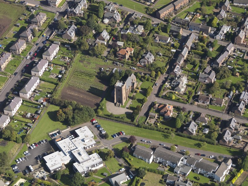 General oblique aerial view of the West Hillbank area of Kirriemiur, centred on St. Mary's Episcopal Church taken from the SW.
