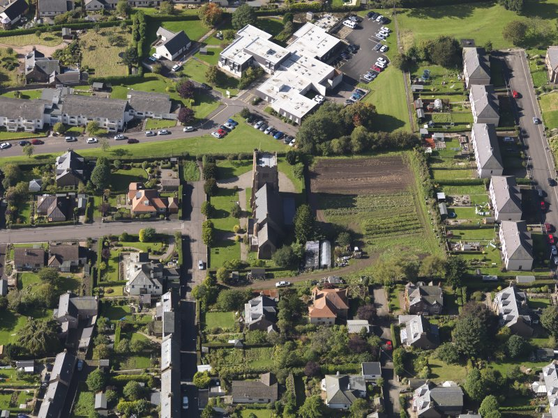 General oblique aerial view of the West Hillbank area of Kirriemiur, centred on St. Mary's Episcopal Church taken from the E.