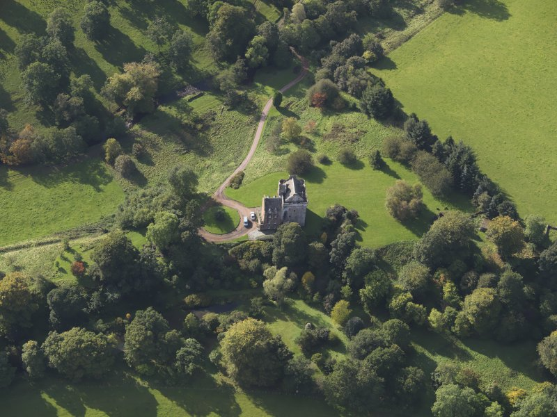 Oblique aerial view of Inverqharity Castle taken from the NE.