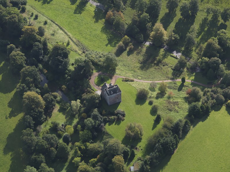 Oblique aerial view of Inverqharity Castle taken from the NW.