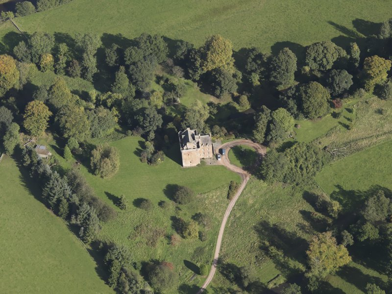 Oblique aerial view of Inverqharity Castle taken from the SW.