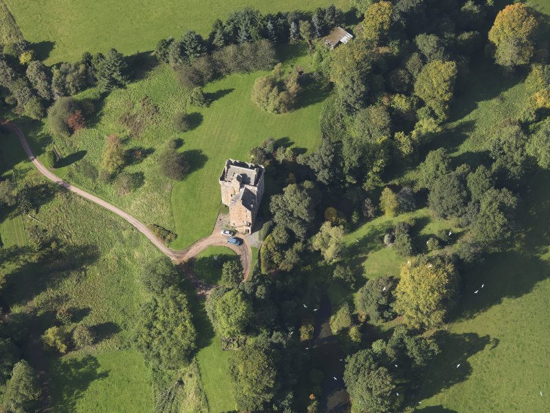 Oblique aerial view of Inverqharity Castle taken from the SE.