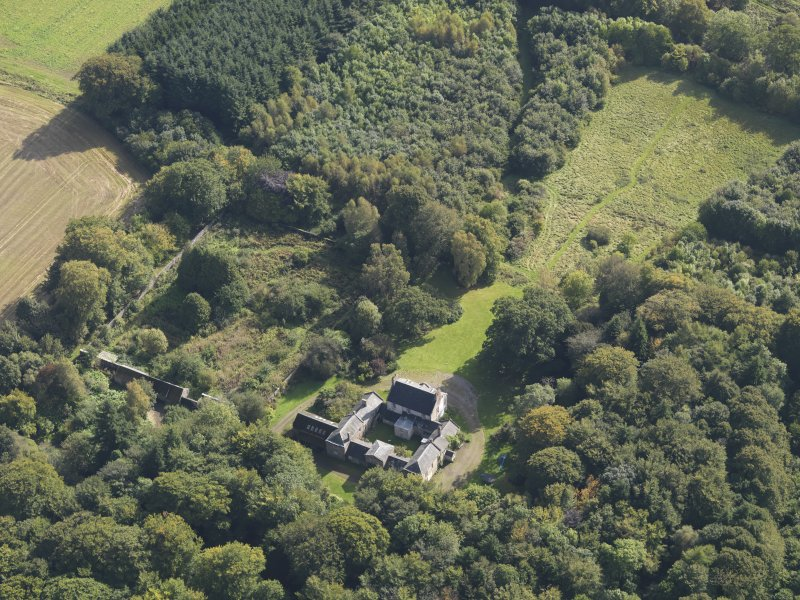 General oblique aerial view of Kintrockat House estate, centred on Kintrockat House, taken from the NW.