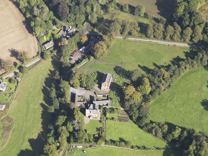 General oblique aerial view of Farnell Village, centred on Farnell Parish Church, taken from the SSW.