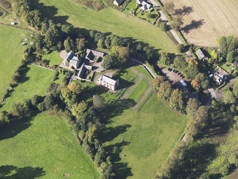 General oblique aerial view of Farnell Village, centred on Farnell Parish Chuch, taken from the SE.