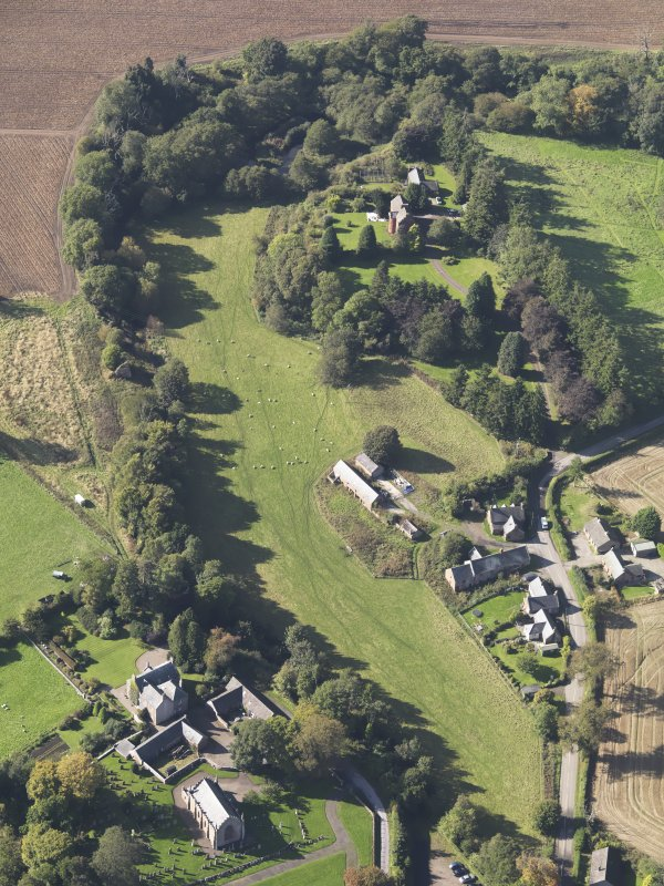 General oblique aerial view of Farnell Village, the Farnell Parish Church in the foreground and Farnell Castle in the background,  taken from the E.