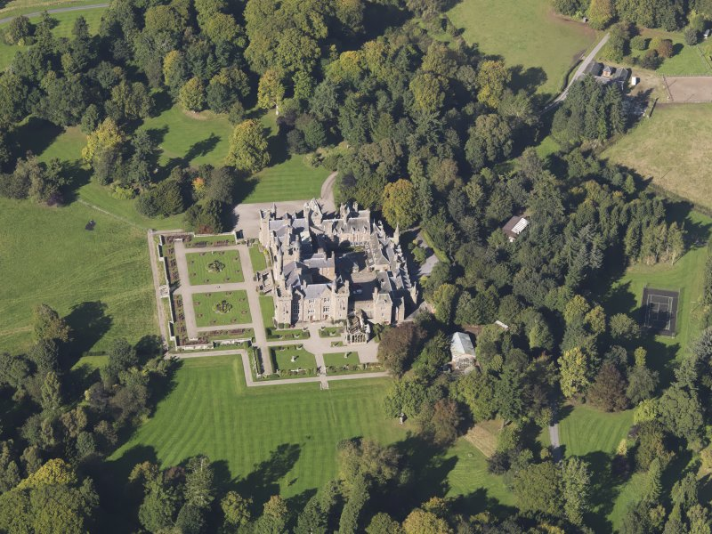 General oblique aerial view of Kinnaird Castle estate, centred on Kinnaird Castle, taken from the SE.