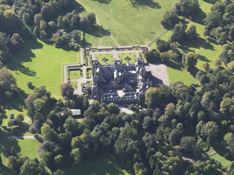 General oblique aerial view of Kinnaird Castle estate, centred on Kinnaird Castle, taken from the E.