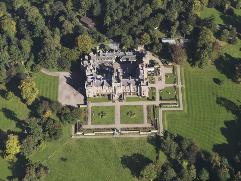 General oblique aerial view of Kinnaird Castle estate, centred on Kinnaird Castle, taken from the SW.