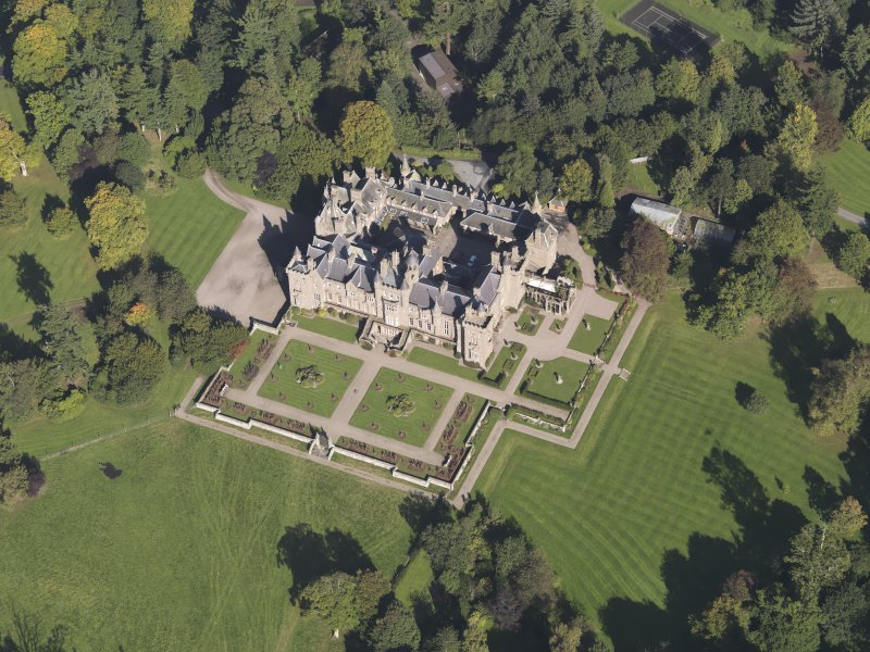 General oblique aerial view of Kinnaird Castle estate, centred on Kinnaird Castle, taken from the SSW.