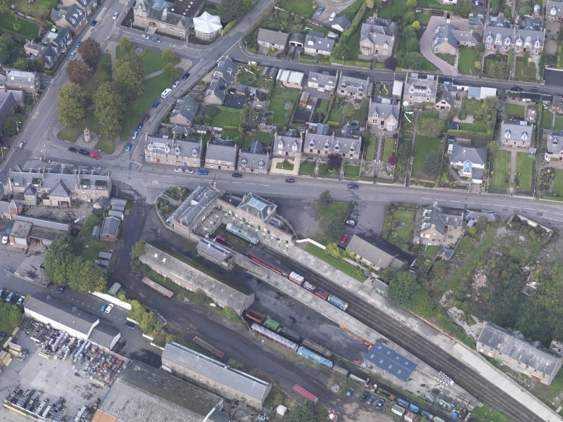 General oblique aerial view of Brechin Railway Terminus, centred the ticket office, taken from the SE.