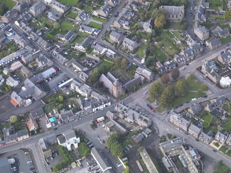 General oblique aerial view of Damacre Road, Brechin, centred the Gardner Memorial Church, taken from the E.