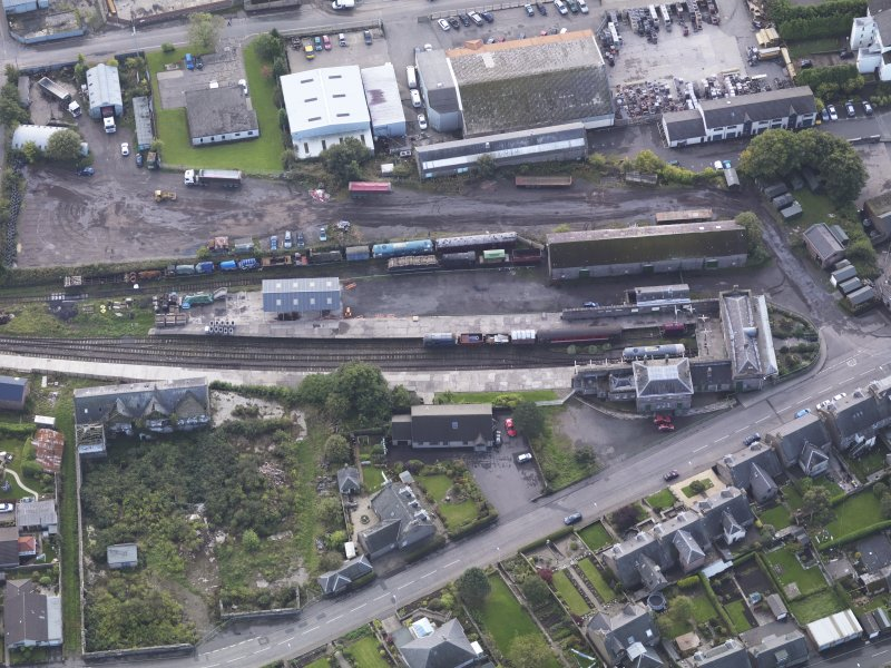 General oblique aerial view of Brechin Railway Terminus, centred the ticket office, taken from the N.