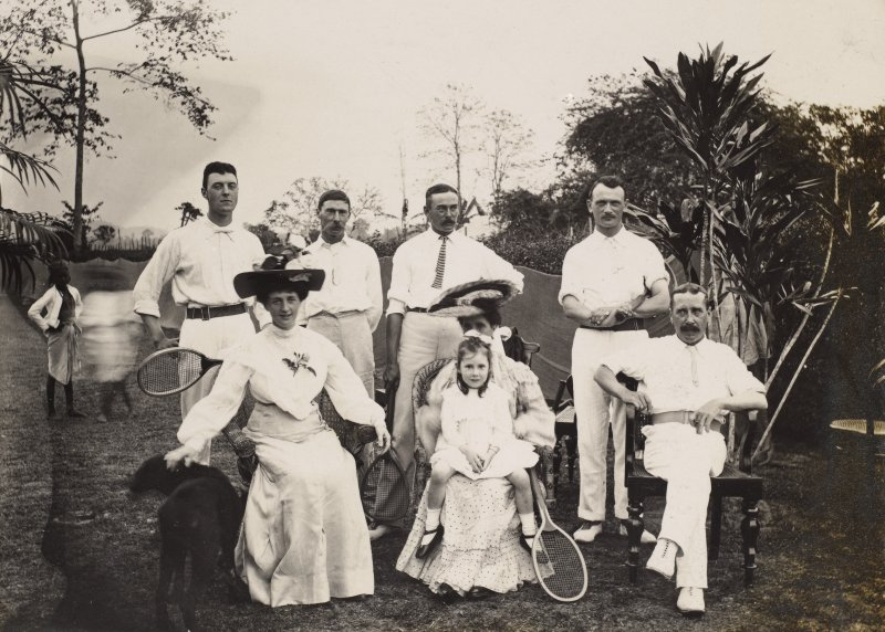 View of group of tennis players, possibly in India.
