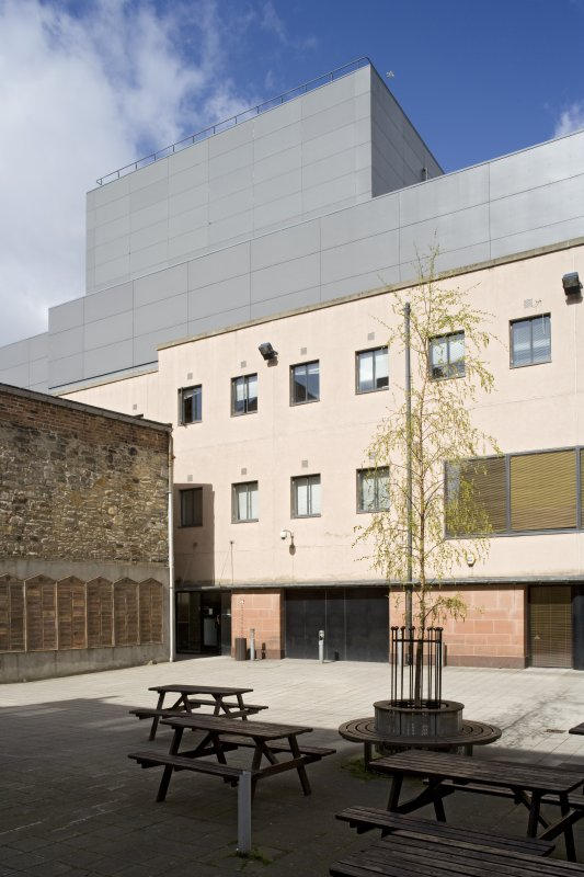 Stage door and fly tower from courtyard to south east.