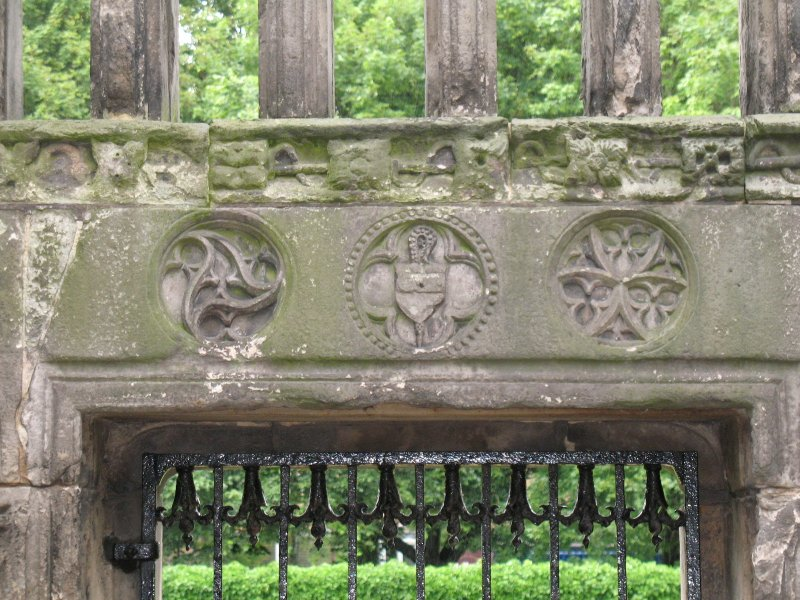 View of arms of Abbot Crawford, on lintel above E door to Holyrood Abbey, in NE corner of nave.