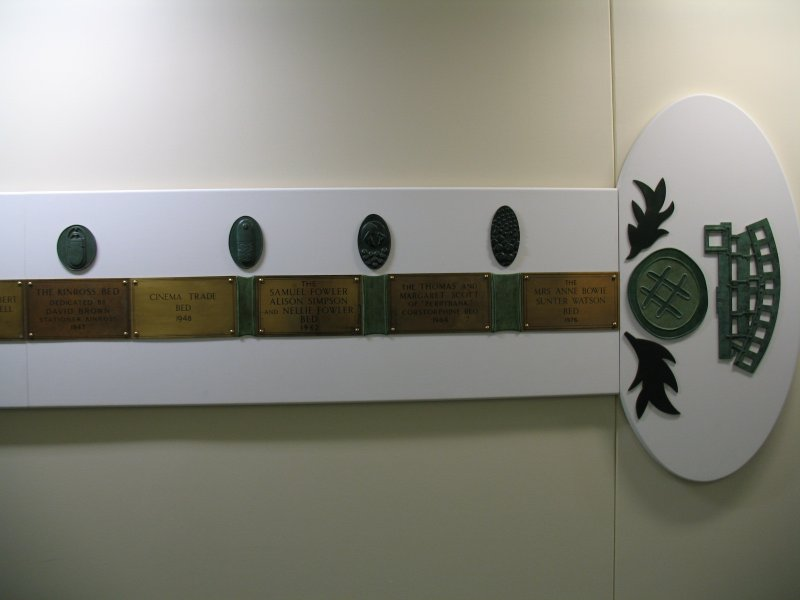 View of 'Narratives' (The Bed Plaque Project'), along wall of N corridor on first floor.