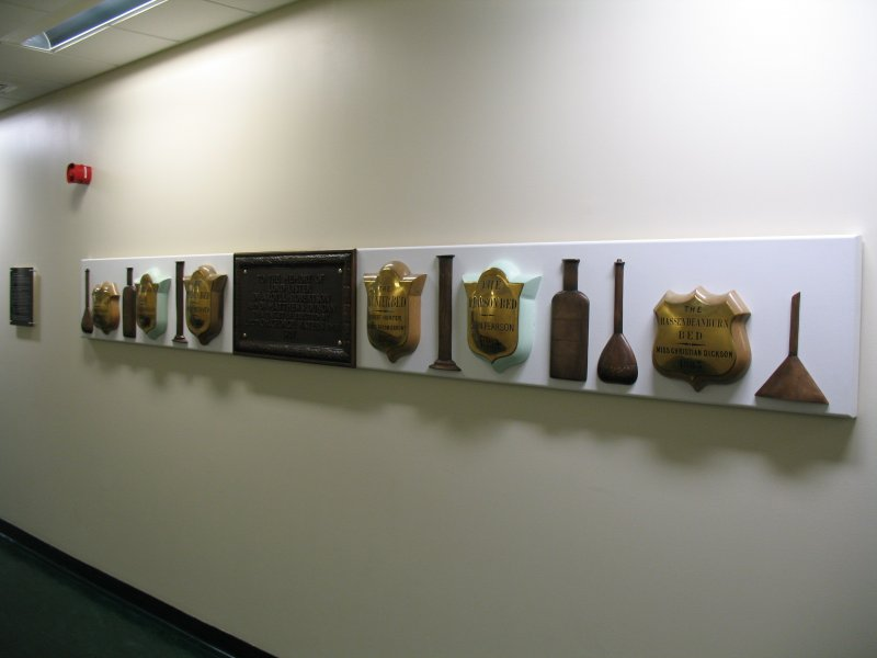 View of 'Narratives' (The Bed Plaque Project'). along wall of N corridor on first floor.