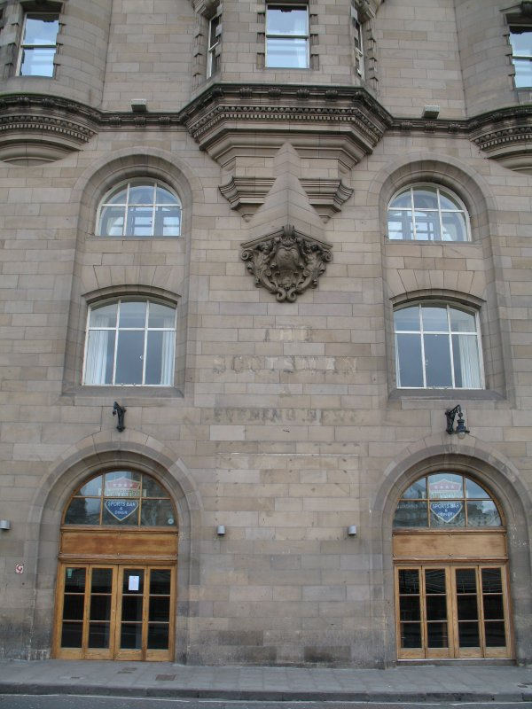 View of facade of 1 Market Street, showing Royal Arms of Scotland and putti with cartouche.