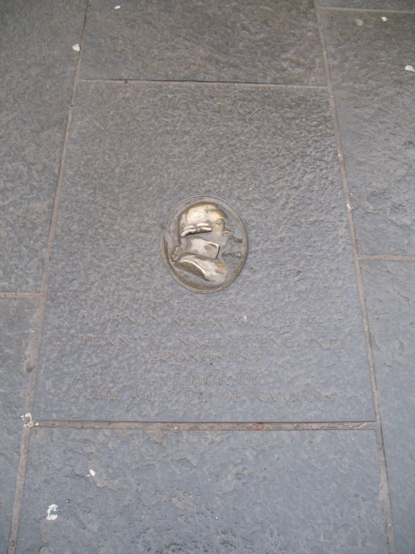 View of Adam Smith medallion, set into pavement outside Canongate Kirk.
