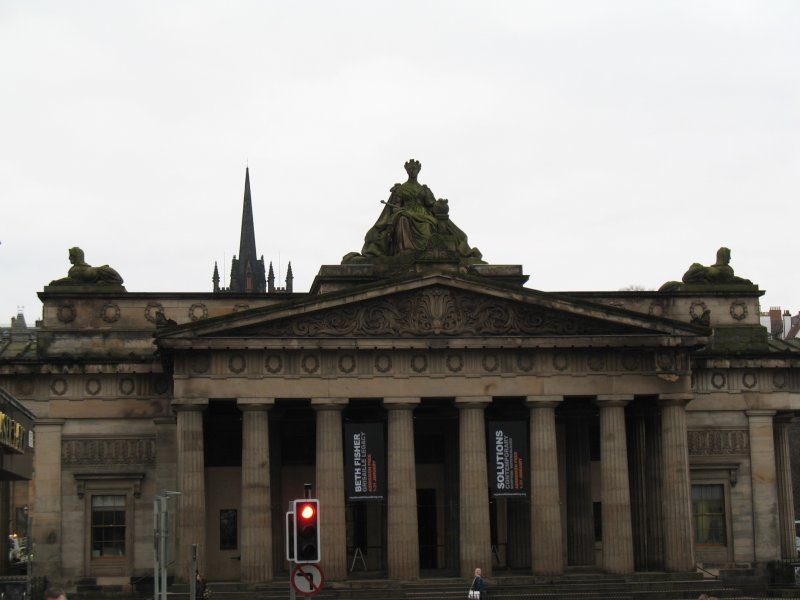 View of statue of Queen Victoria and sphinxes, on roof of Royal Scottish Academy.