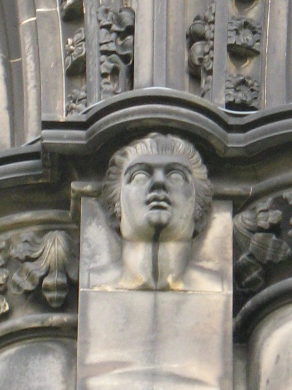 View of head of Robert Fergusson, at top of pilaster on W side(facing W).