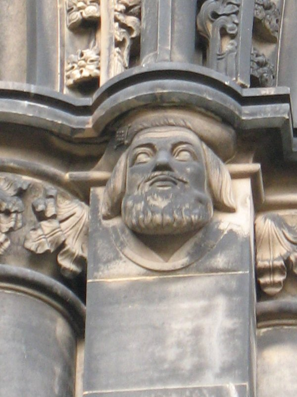 View of head of Sir David Lindsay of the Mount, at top of pilaster on S side (facing S).
