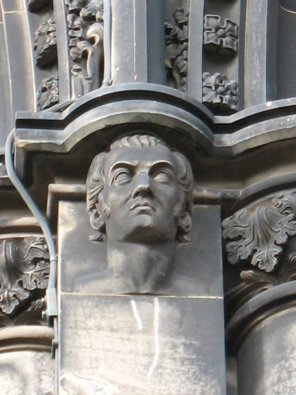 View of head of Lord Byron, at top of pilaster on S side (facing W).