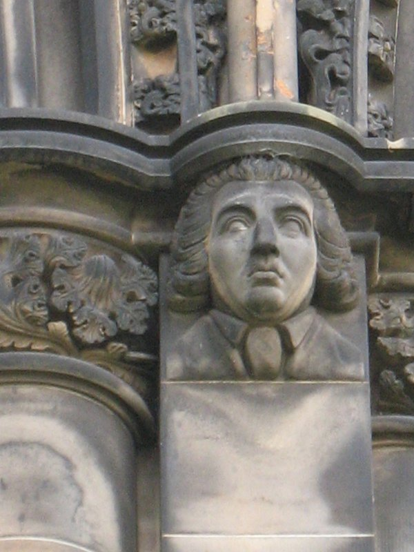View of head of James Beattie, at top of pilaster on E side (facing E).
