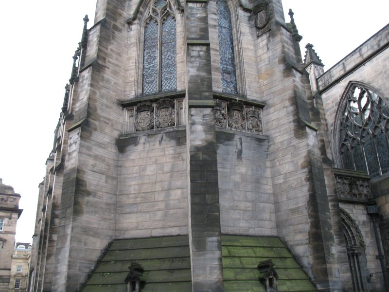 View of carved coats of arms on exterior of Thistle Chapel.