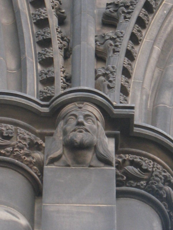 View of head of King James I, at top of pilaster on N side (facing N).