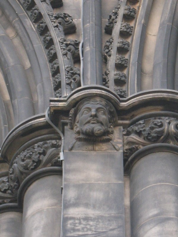 View of head of King James V, at top of pilaster on N side (facing N).
