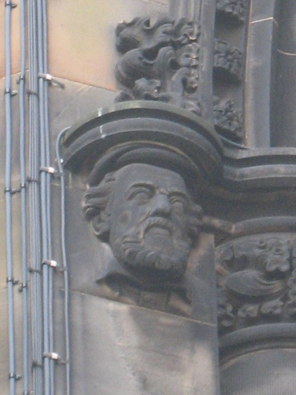 View of head of George Buchanan, at top of pilaster on S side (facing E).