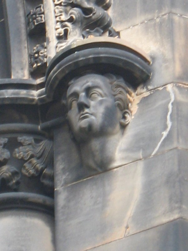 View of head of Robert Tannahill, at top of pilaster on S side (facing S).