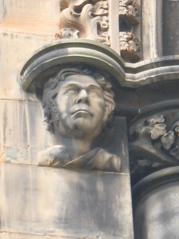 View of head of James Hogg, at top of pilaster on W side (facing S).