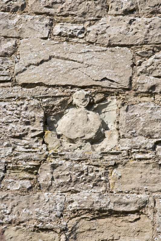 Sundial remnant on S wall. Detail  (or perhaps a smiling nun!)