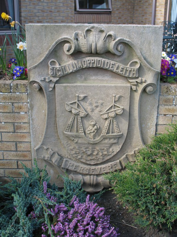 View of stone carved with Leith coat of arms, beside entrance to Ferryfield House.