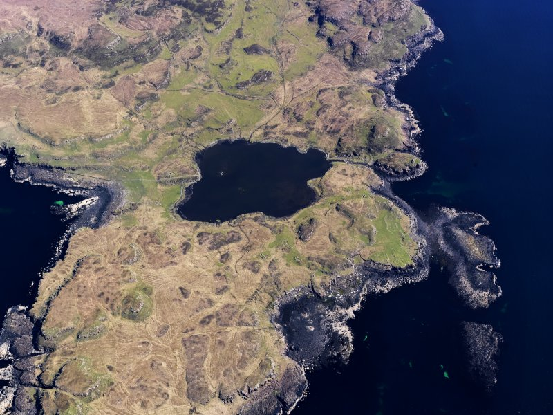 Oblique aerial view centred on Loch na h-Airde, the 'Viking Canal' and Rubh' an Dunain, taken from the SW.