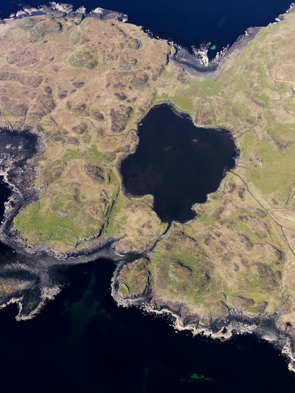 Oblique aerial view centred on Loch na h-Airde, the 'Viking Canal' and Rubh' an Dunain, taken from the SSE.