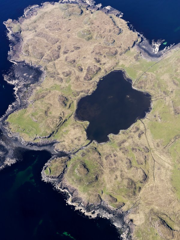 Oblique aerial view centred on Loch na h-Airde, the 'Viking Canal' and Rubh' an Dunain, taken from the SE.