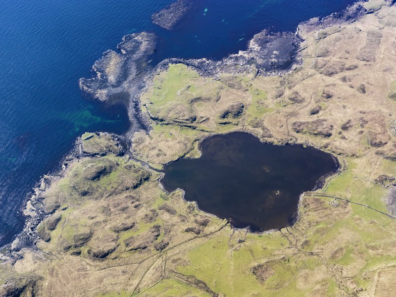 Oblique aerial view centred on Loch na h-Airde, the 'Viking Canal' and Rubh' an Dunain, taken from the NE.