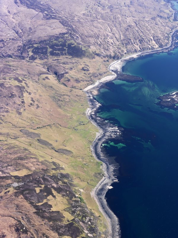 General oblique aerial view centred on the remains of the township and dun at Boreraig, taken from the W.