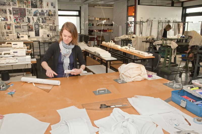 View of students working within the dressmaking studio of the textiles department in Newbery Tower