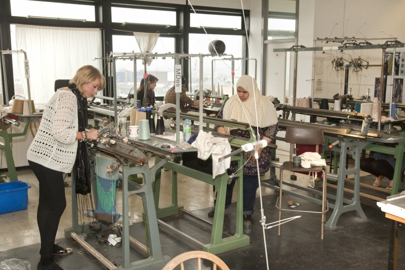 View of students working at the Dubied knitting machines of the Textiles department within Newbery Tower