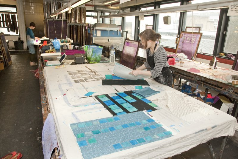 View of students working at the printing tables of the printmaking workshop within Newbery Tower