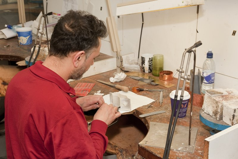 View of student at a workstation within the silversmithing and jewellery studios of Newbery Tower